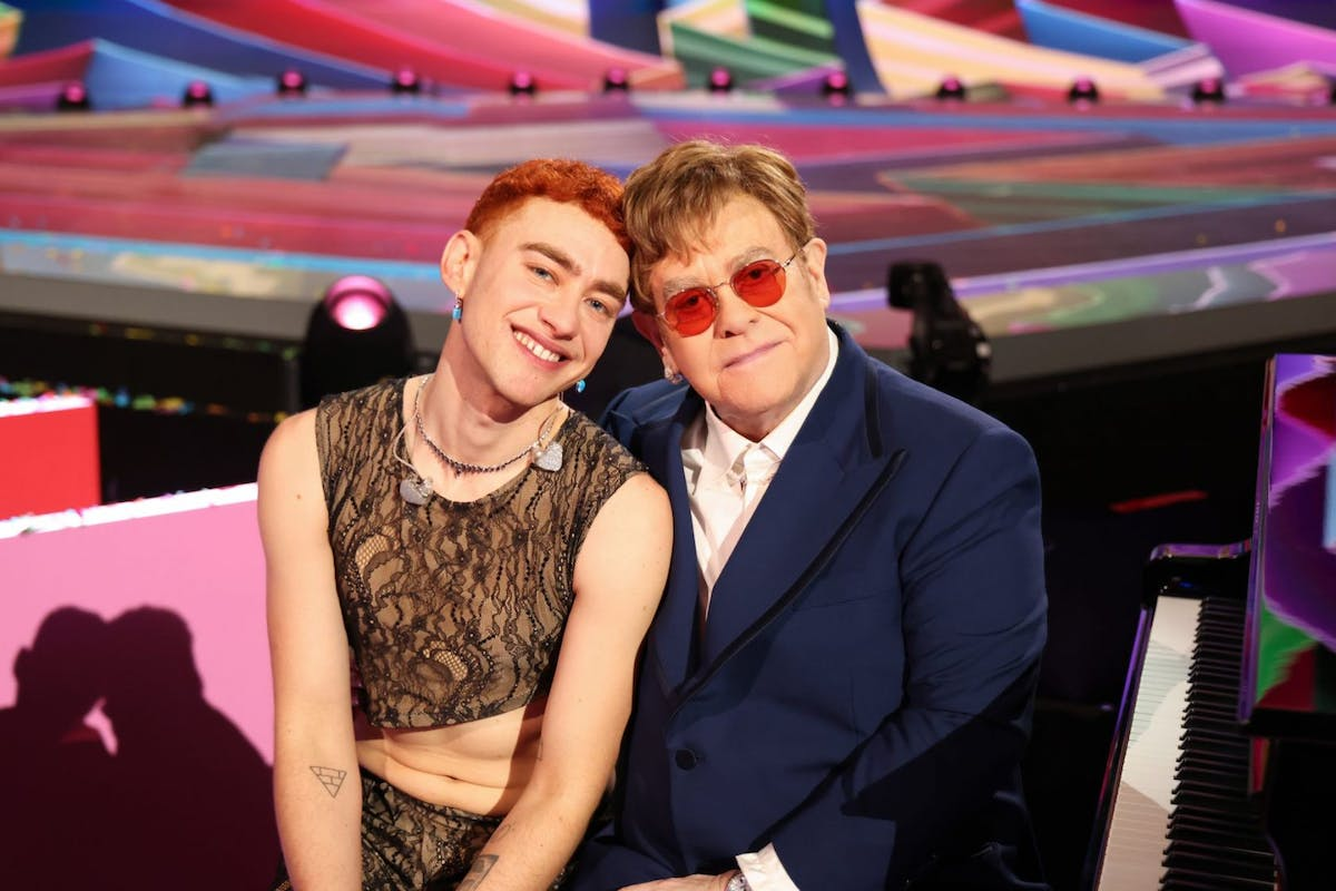 Sir Elton John poses with Olly Alexander during The BRIT Awards 2021 at The O2 Arena on May 11, 2021 in London, England. (Photo by JMEnternational/JMEnternational for BRIT Awards/Getty Images)