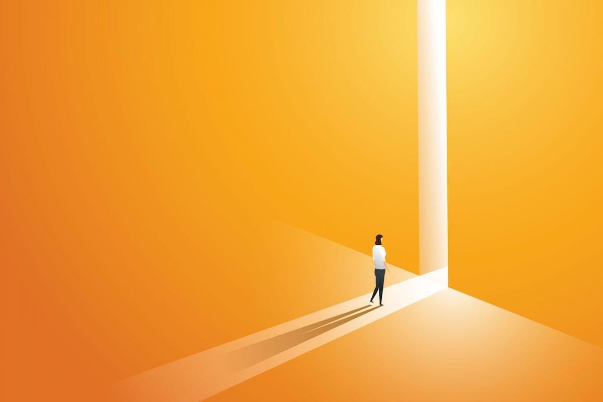 A woman walking through a shining door