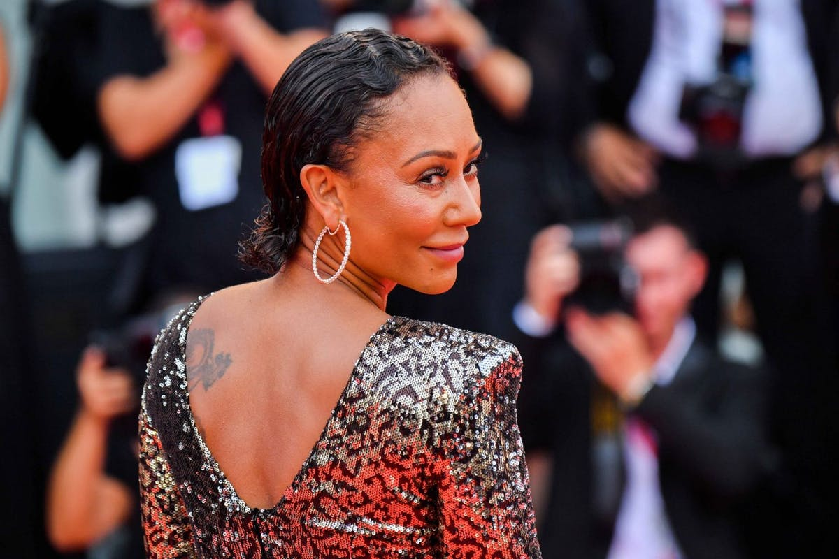 """Melanie Brown walks the red carpet ahead of the opening ceremony during the 76th Venice Film Festival at Sala Casino on August 28, 2019 in Venice, Italy. (Photo by Stephane Cardinale - Corbis/Corbis via Getty Images)Mel B recalls the """"tiny"""" red flags she missed in her abusive relationship"""