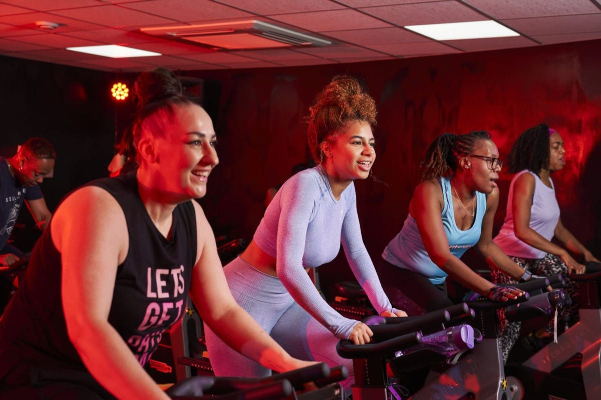 Three women on bikes during a spin class