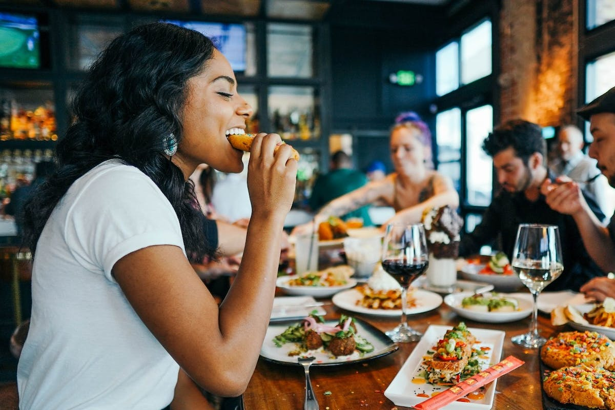 A woman eating food in a restaurant
