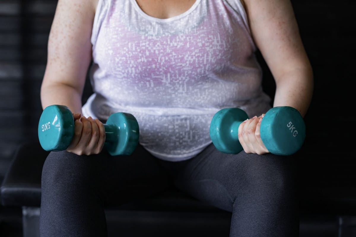 Plus size exercising person