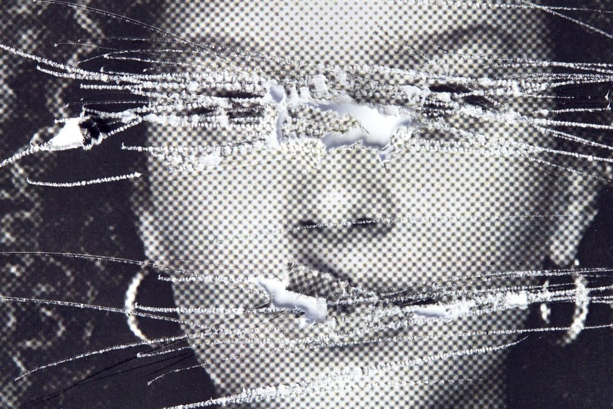 Picture Of Woman's face. Defaced And Torn.