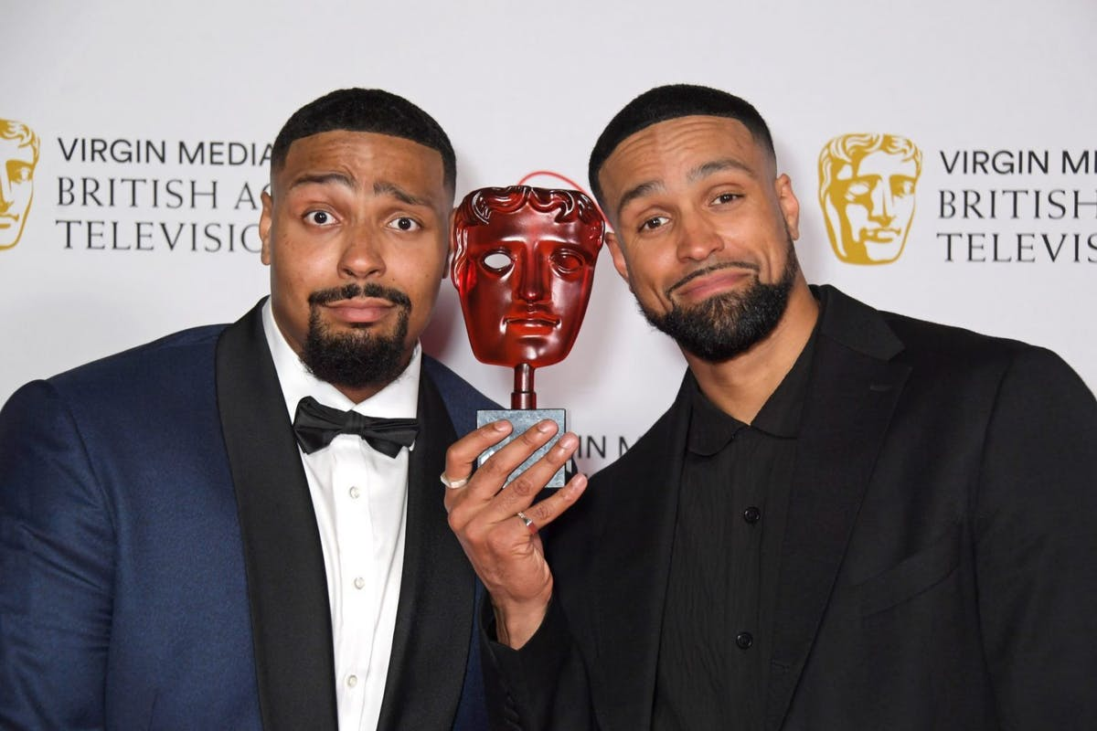 """Jordan Banjo (L) and Ashley Banjo, accepting Virgin Medias Must-See Moment award for Diversity's performance on """"Britain's Got Talent"""", pose in the Winners Room at the Virgin Media British Academy Television Awards 2021 at Television Centre on June 6, 2021 in London, England. (Photo by David M. Benett/Dave Benett/Getty Images)"""