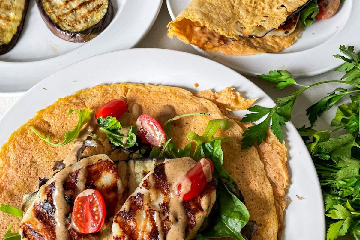 Red lentil wrap with aubergine and halloumi on a table