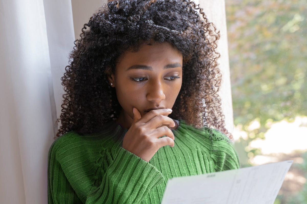Worried woman reading eviction notice