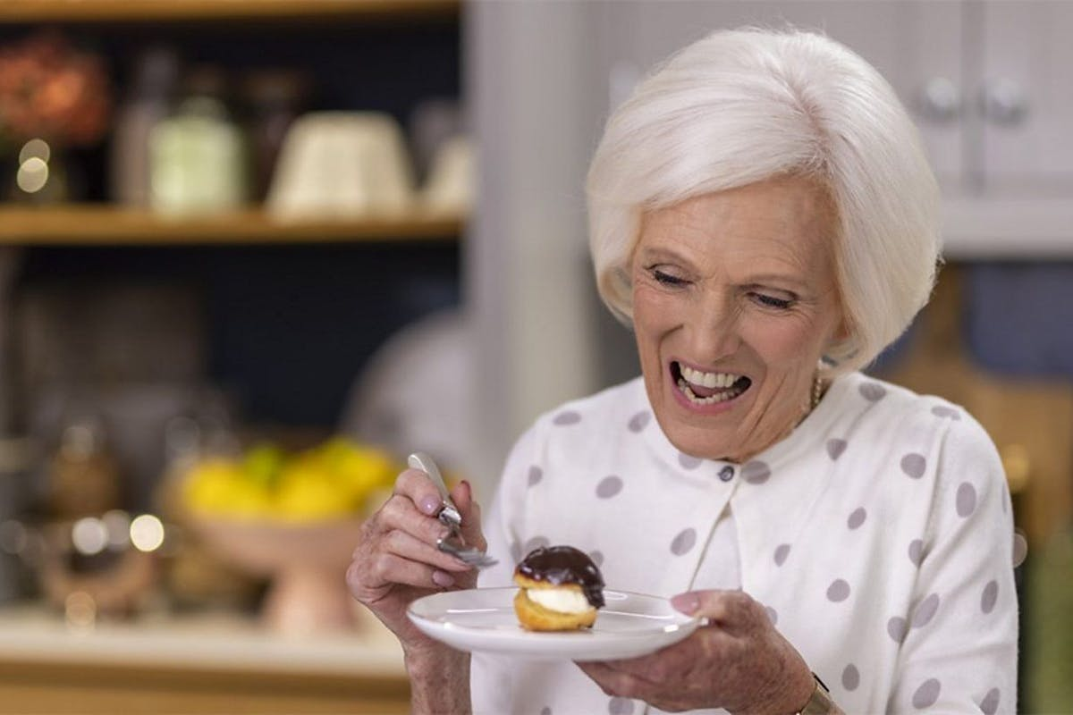 Mary Berry smiles at a profiterole inLove To Cook