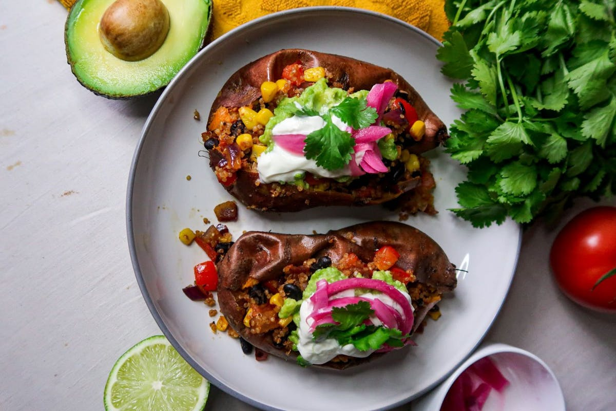 Chipotle sweet potato with black beans and avocado on top