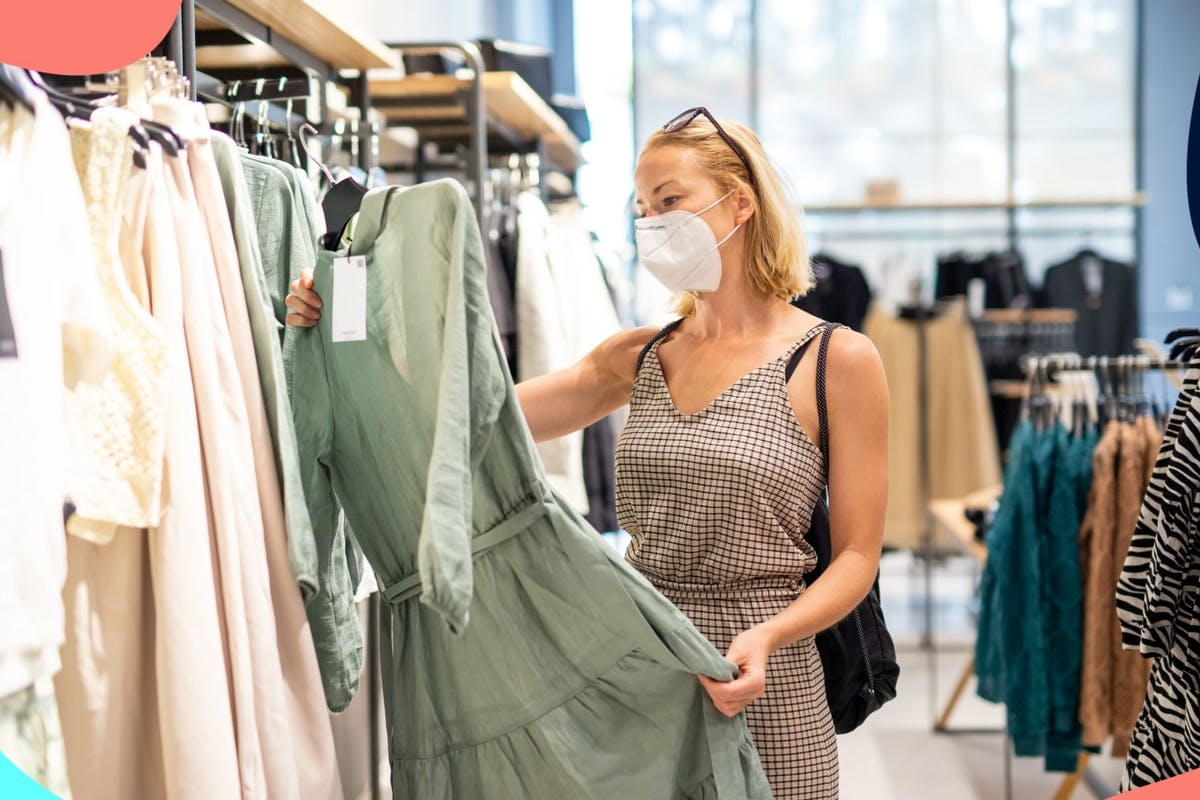blonde woman wearing mask clothes shopping