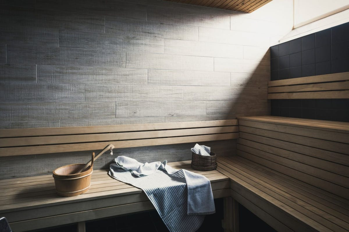 A sauna with a steam bowl and towel.