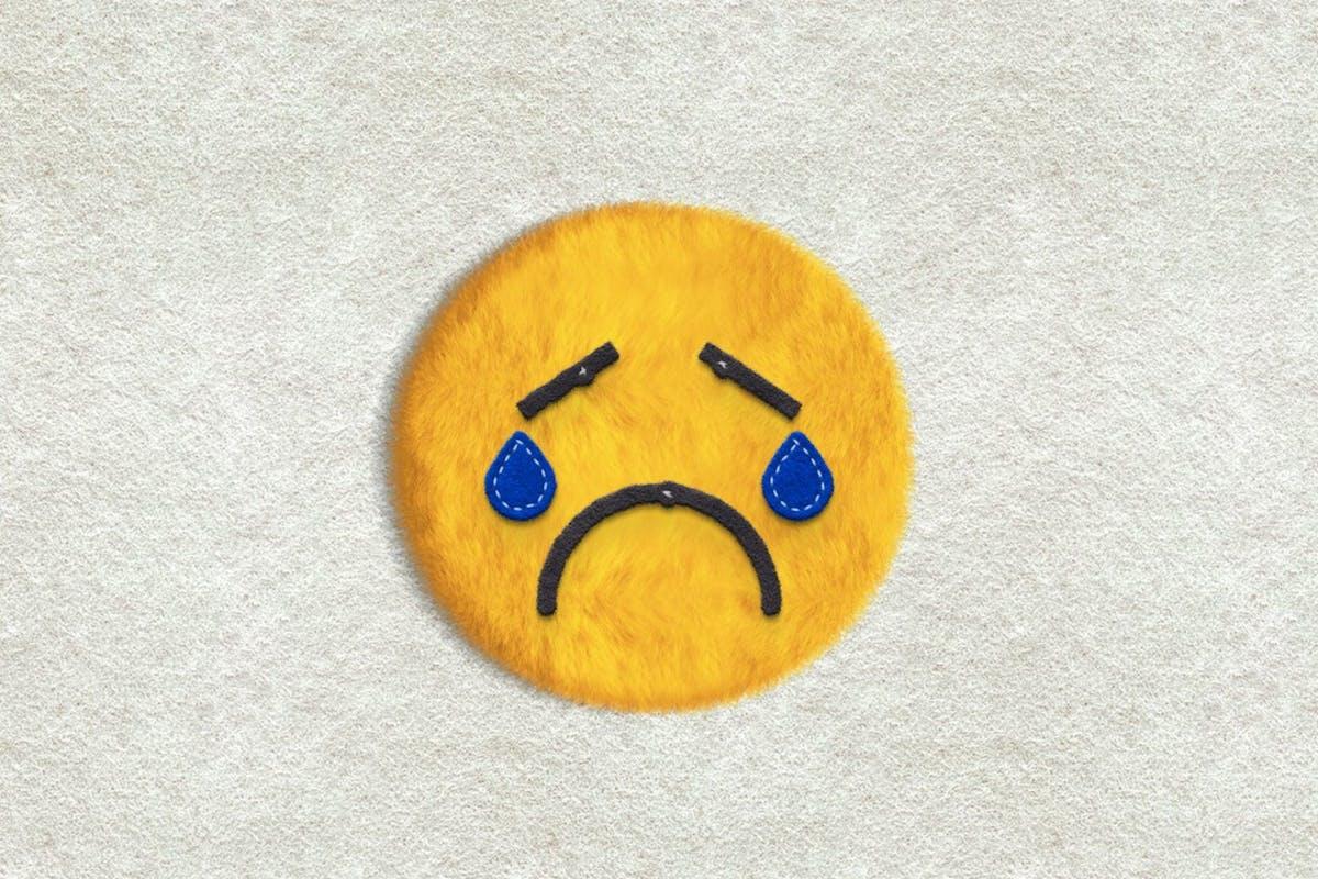 Psychology of sadness: sad felt emoji crying
