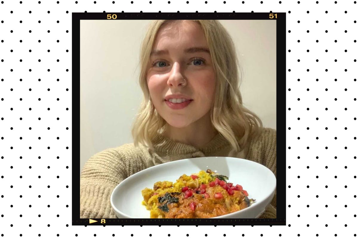 Chloe with a plate of veggie curry
