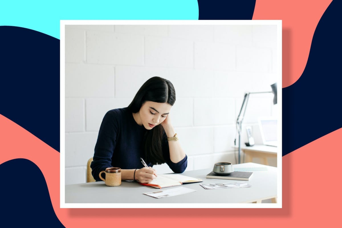 woman sitting at desk, working.