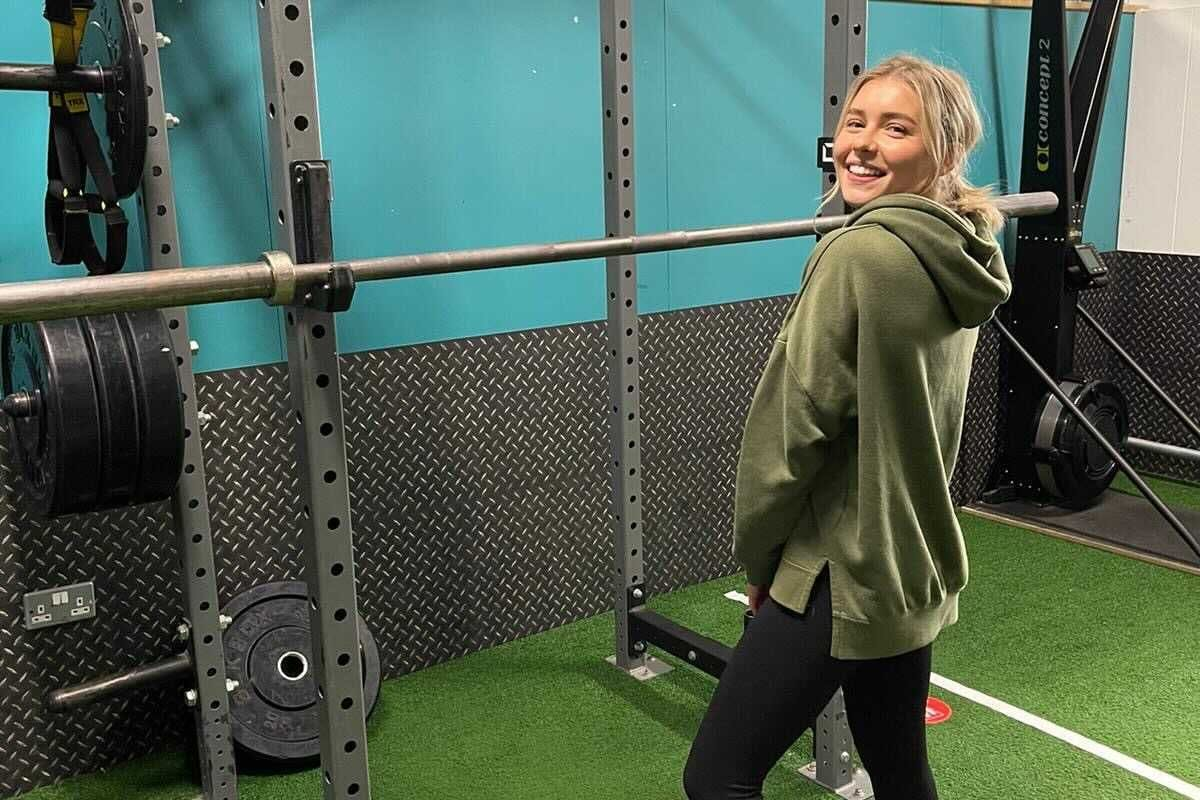 Chloe Gray with a squat rack