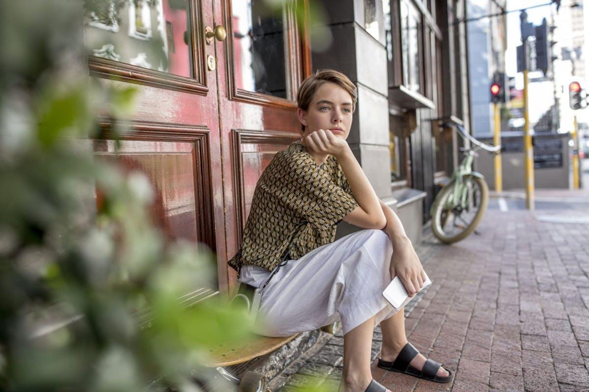 Woman sad on doorstep