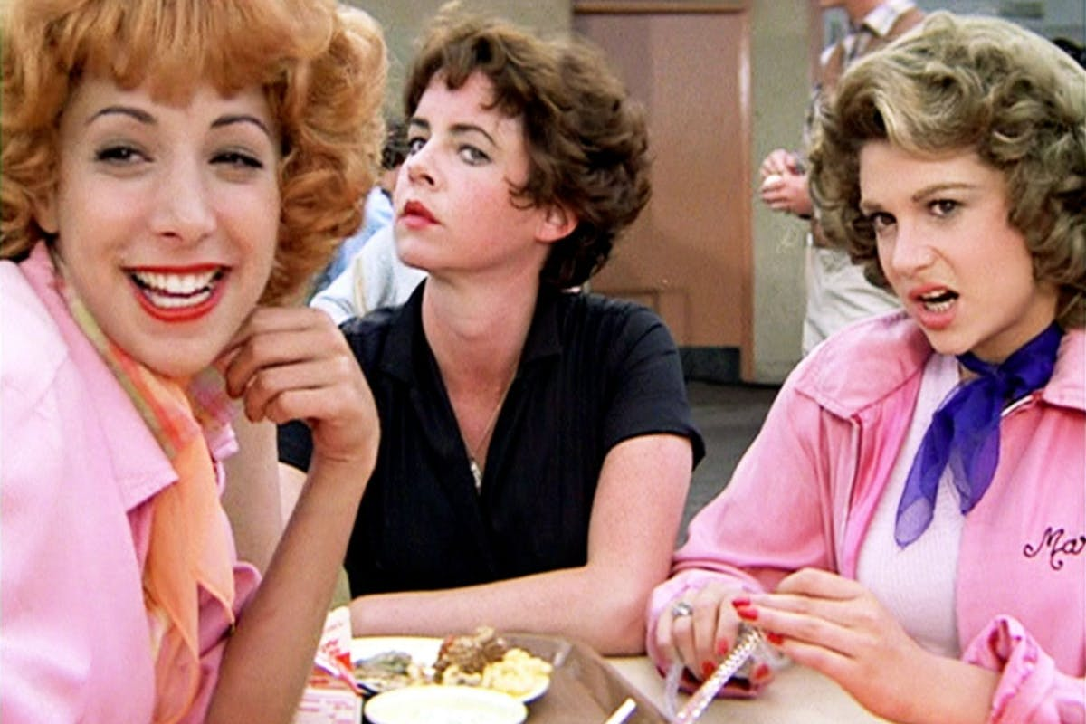 """The movie """"Grease"""", directed by Randal Kleiser. Seen here, members of the Pink Ladies. From left, Didi Conn as Frenchy, Stockard Channing as Betty Rizzo and Dinah Manoff as Marty Maraschino.Initial theatrical release of the film, June 16, 1978. Screen capture. Paramount Pictures. (Photo by CBS via Getty Images)"""