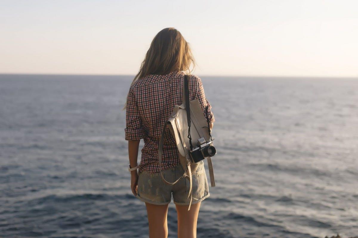 Woman stares across the ocean