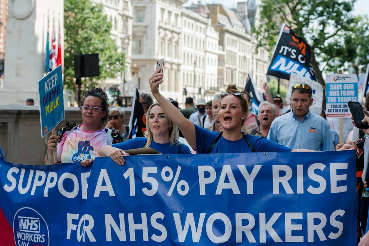 Nurses marching in London yesterday to demand a 15% pay rise