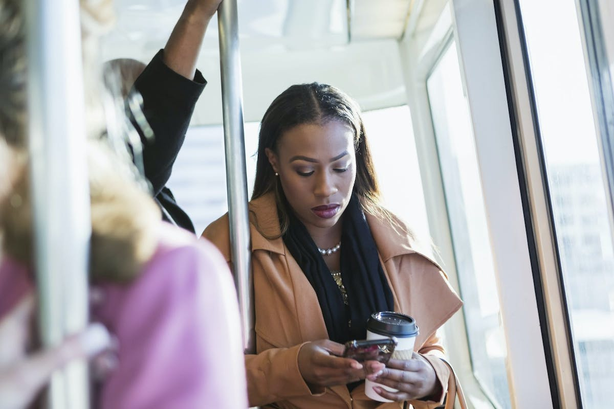 Woman on the bus with her phone