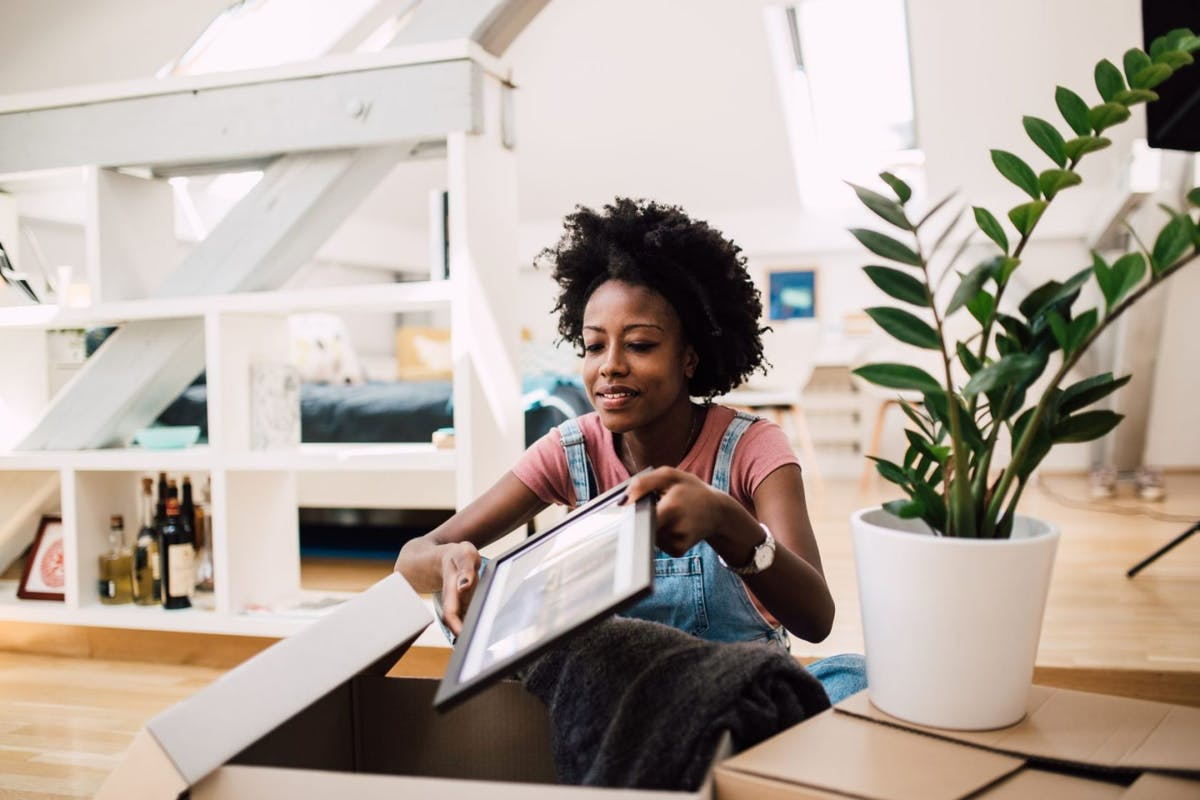 young woman moving into new rented home instead of buying a house