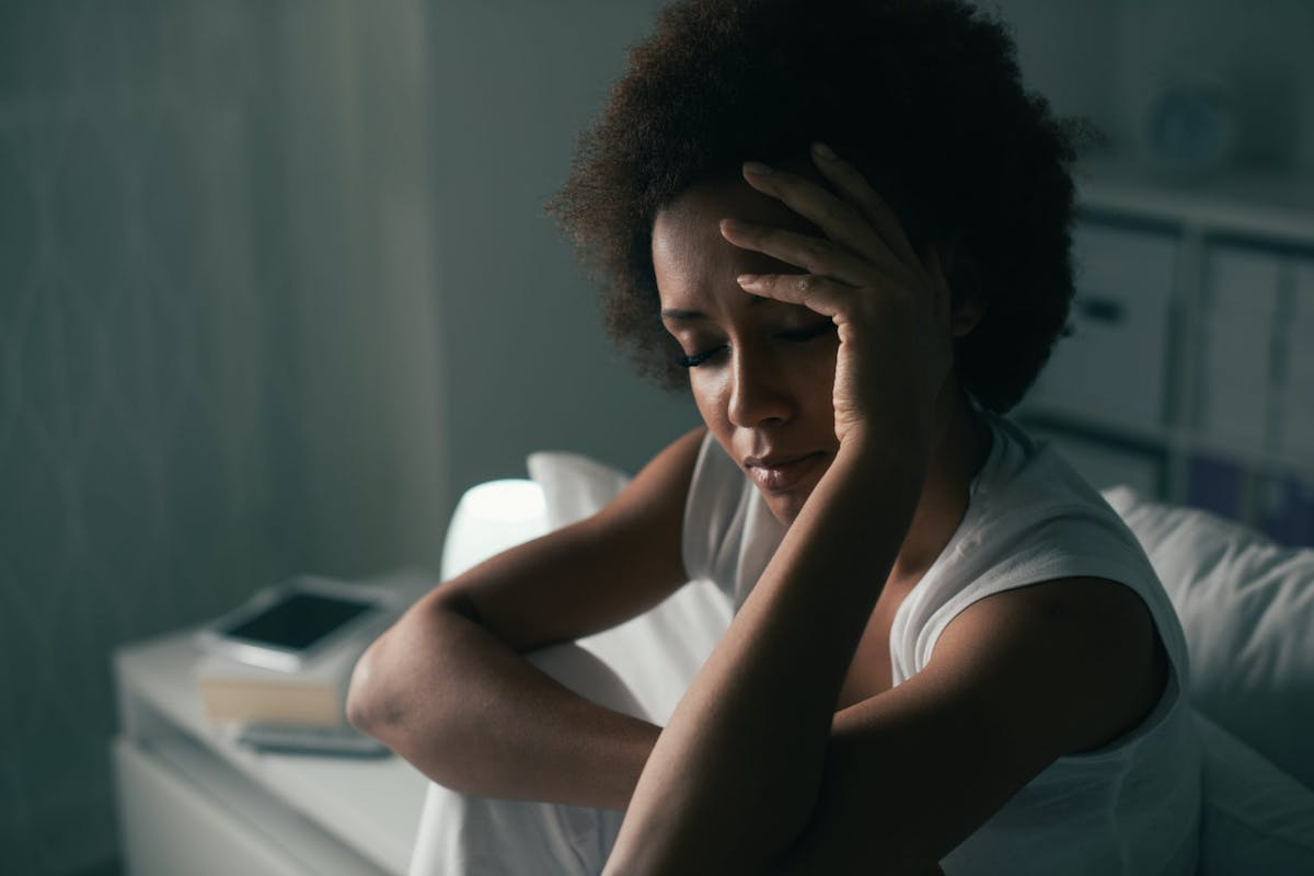 A woman struggling with insomnia at night