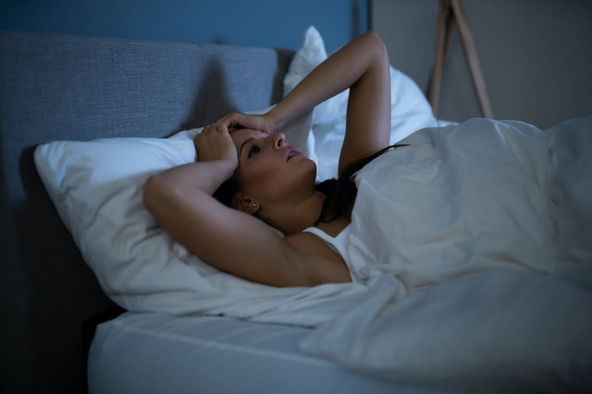 A woman struggling to sleep