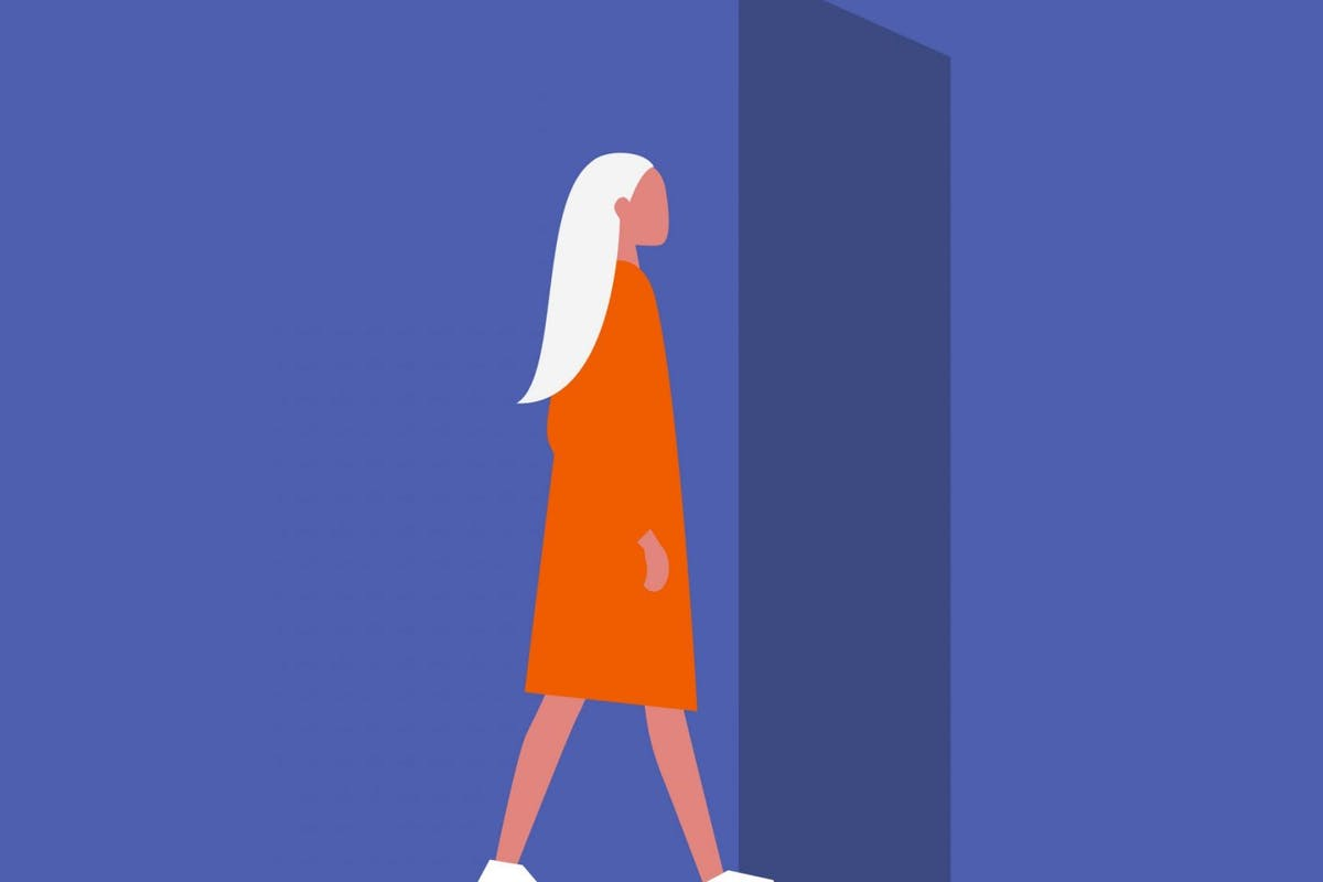 A woman walking through the door