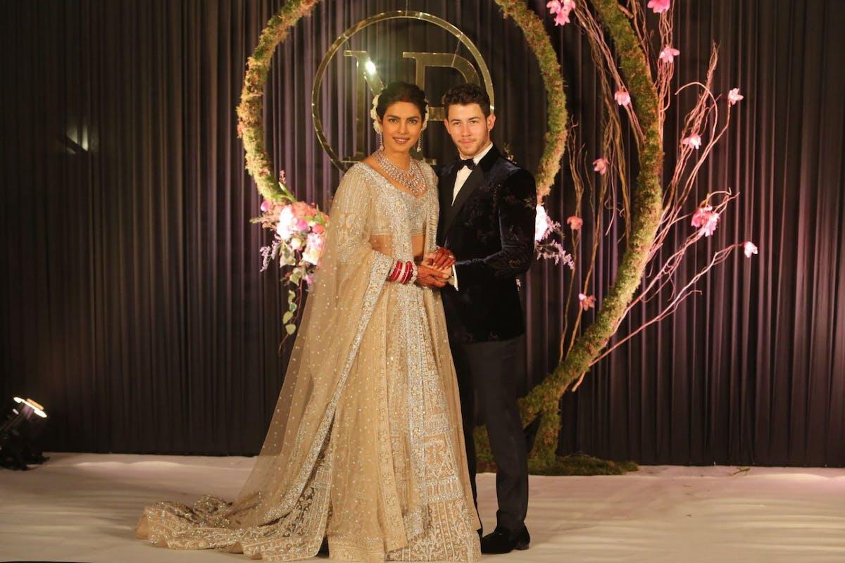 Priyanka Chopra-Jonas wearing a gold lehenga choli by Falguni Shane Peacock