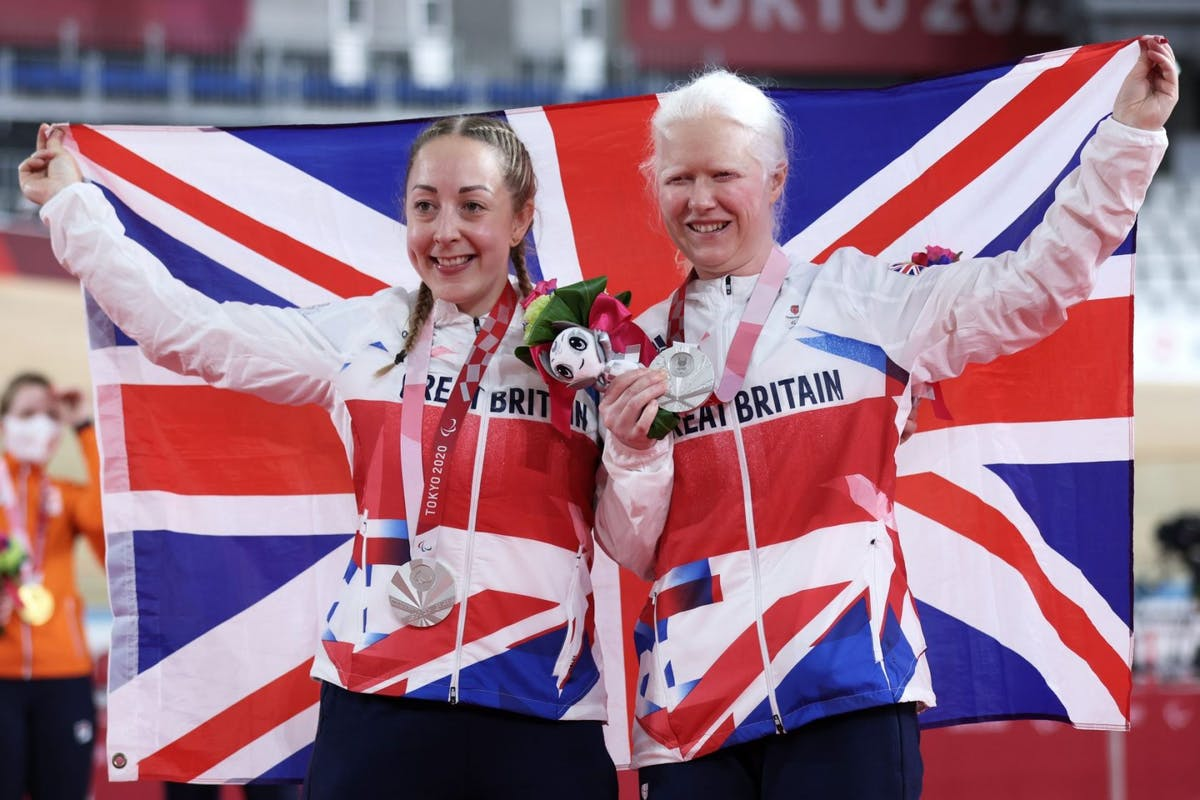 Aileen McGlynn and Helen Scott on the podium at tokyo 2020 with the union jack