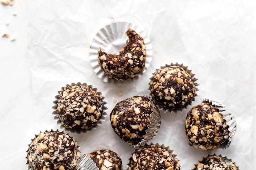 Chocolate and hemp seed energy balls on a table