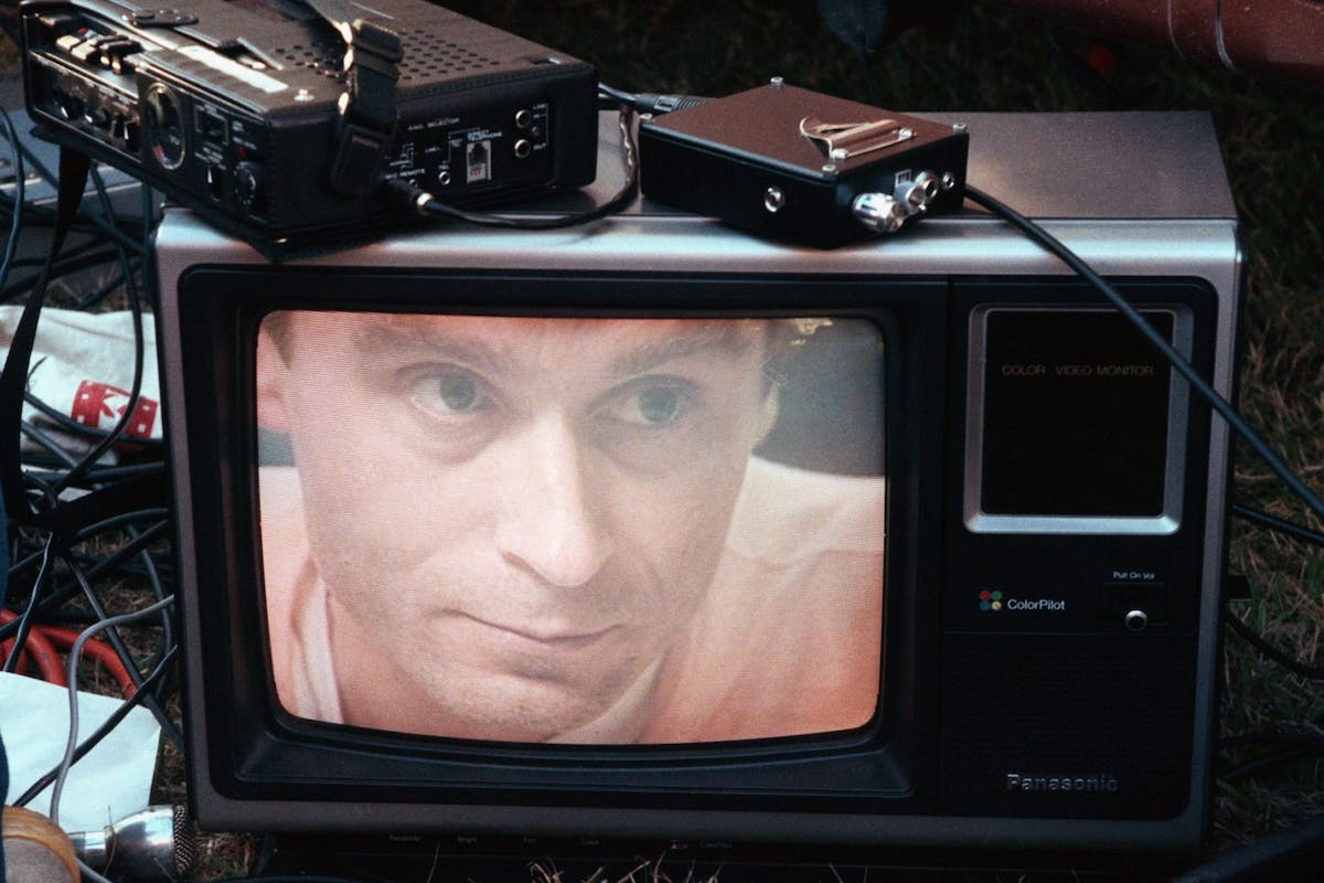 Ted Bundy's image on a television screen on the lawn of the Florida State Prison. | Location: Starke, Florida, USA.