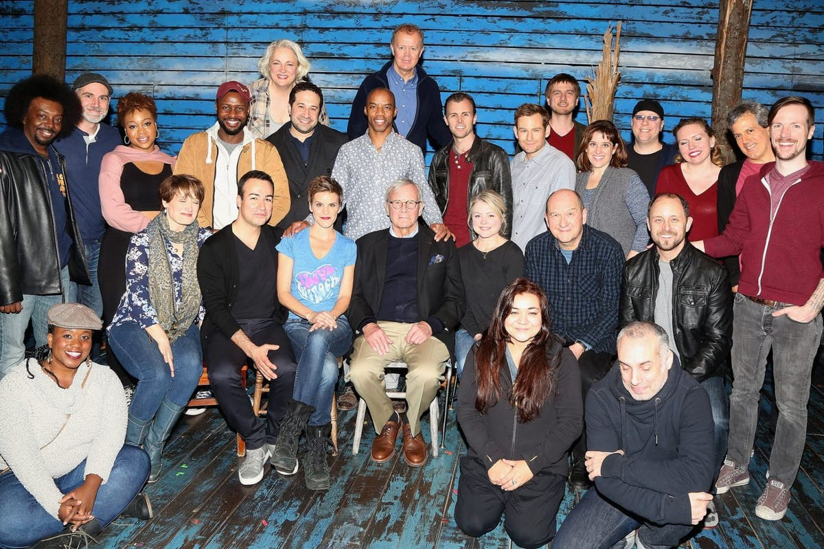 """Tom Brokaw pose with the cast backstage at the hit musical """"Come From Away"""" on Broadway (Brokaw was the news anchor who reported on the town of Gander in Newfoundland that helped 911 planes divert and land safely on September 11, 2001 which is the setting of the show) at The Schoenfeld Theater on February 21, 2017 in New York City. (Photo by Bruce Glikas/FilmMagic)"""