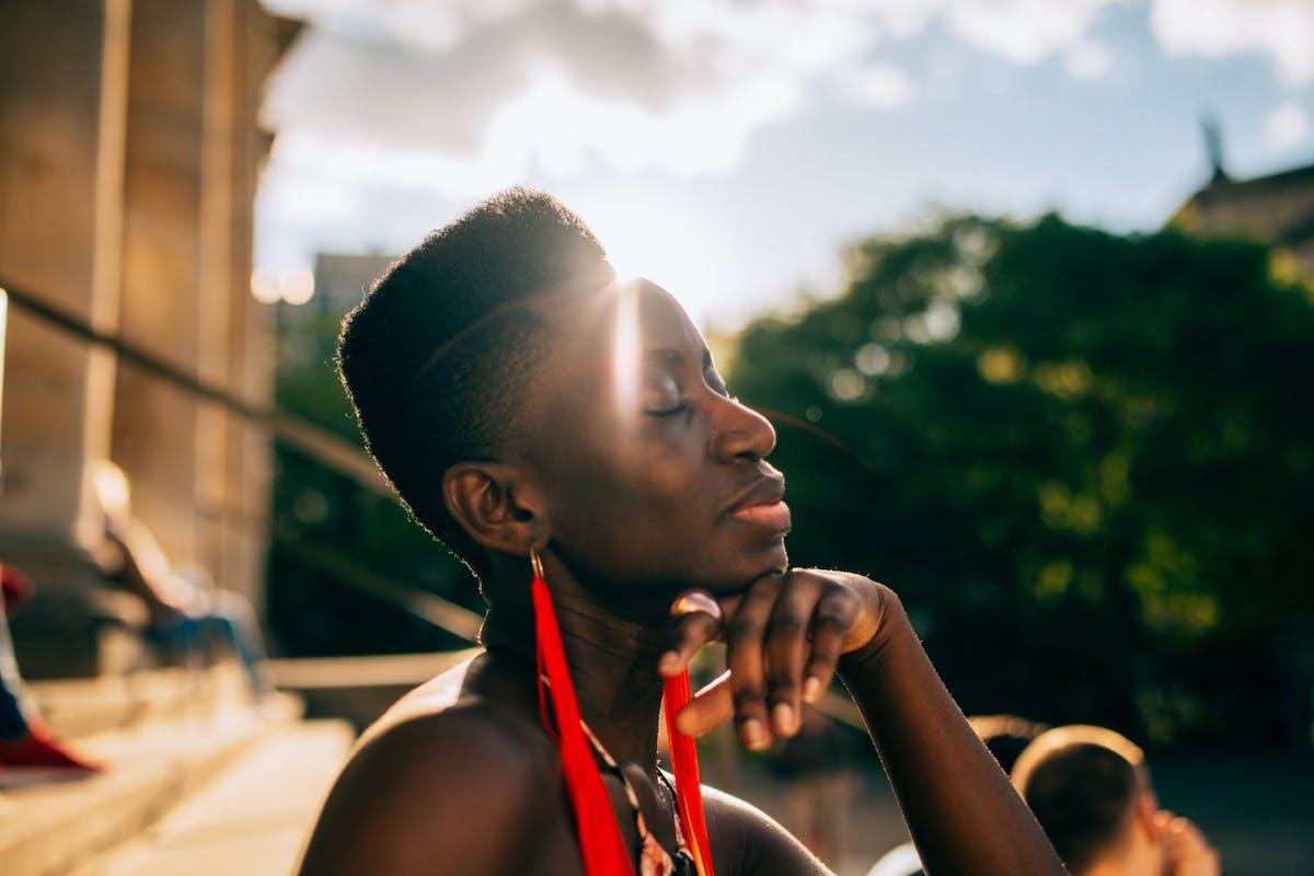 A woman sat in the sun