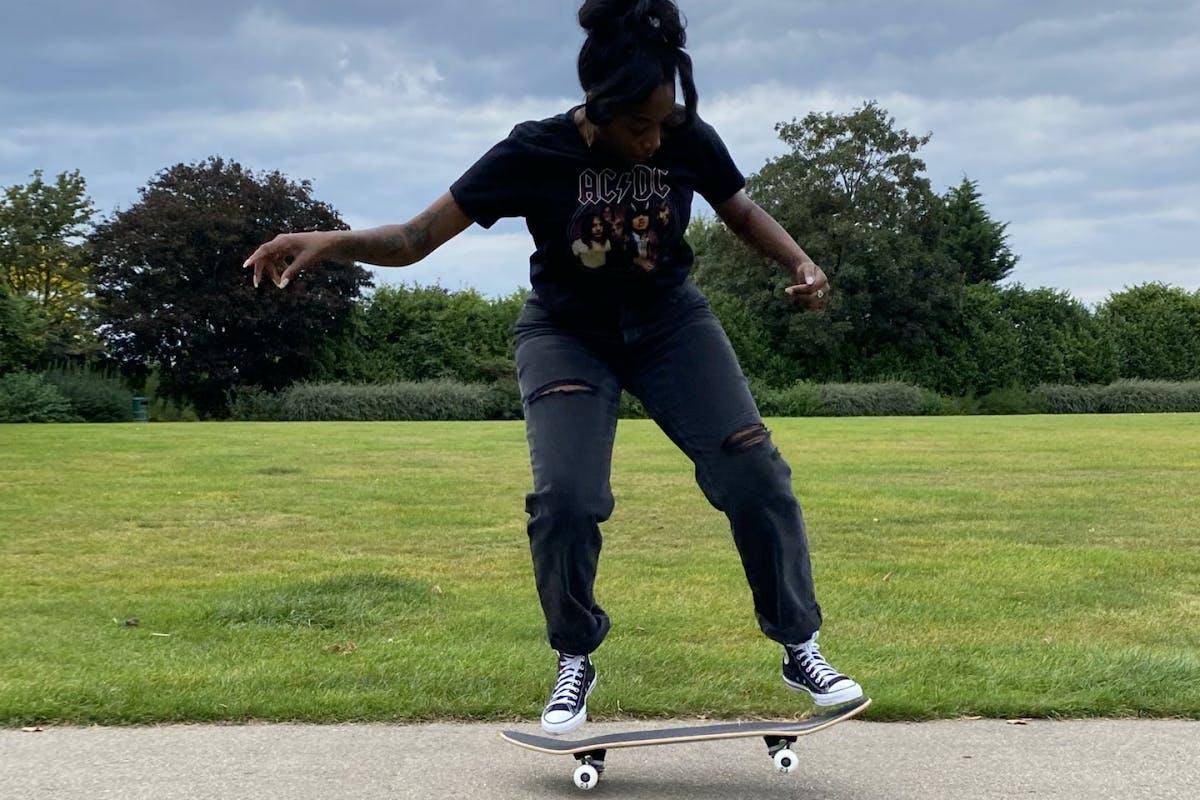 woman riding a skateboard in a park