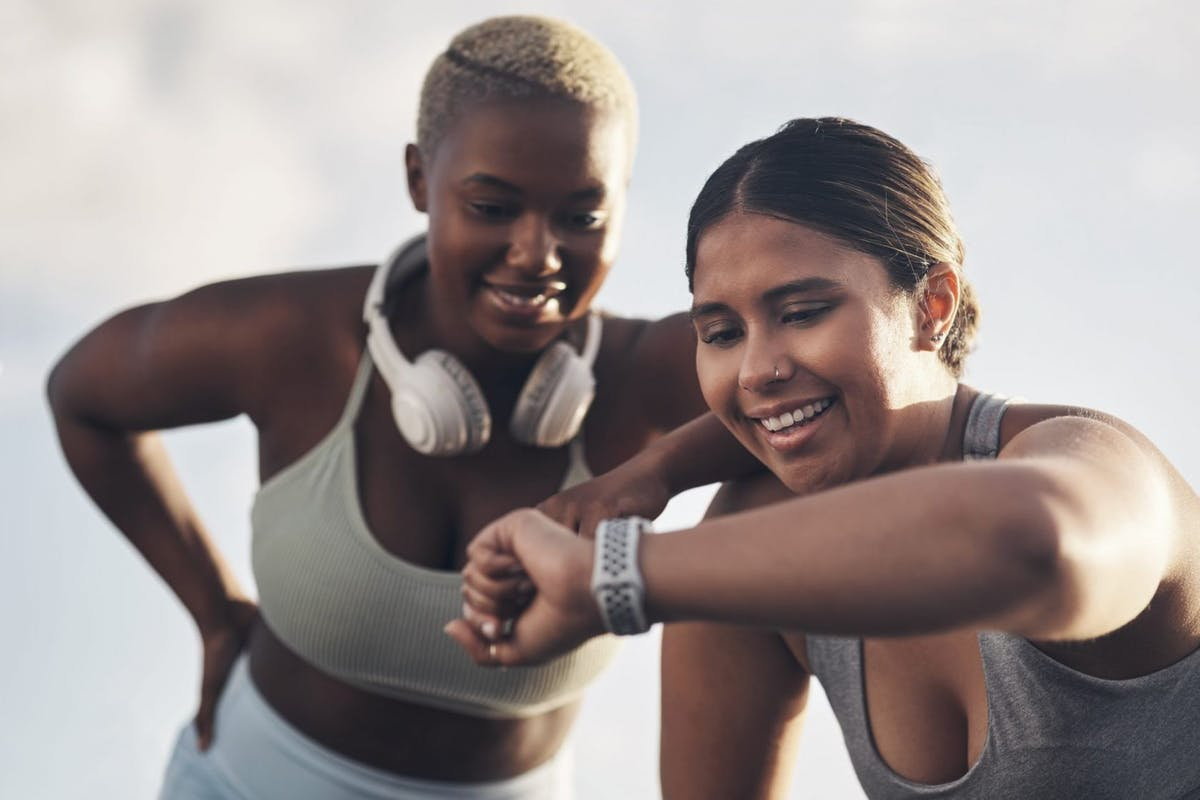 Two women smiling while doing exercise