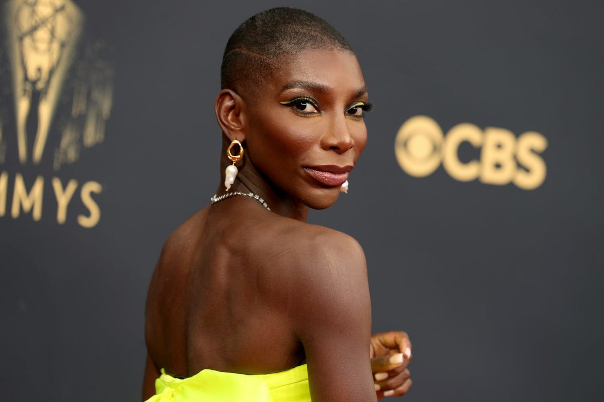 Michaela Coel looking over her shoulder at the Emmy awards.