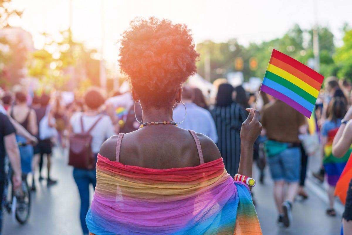 Woman draped in Pride flag