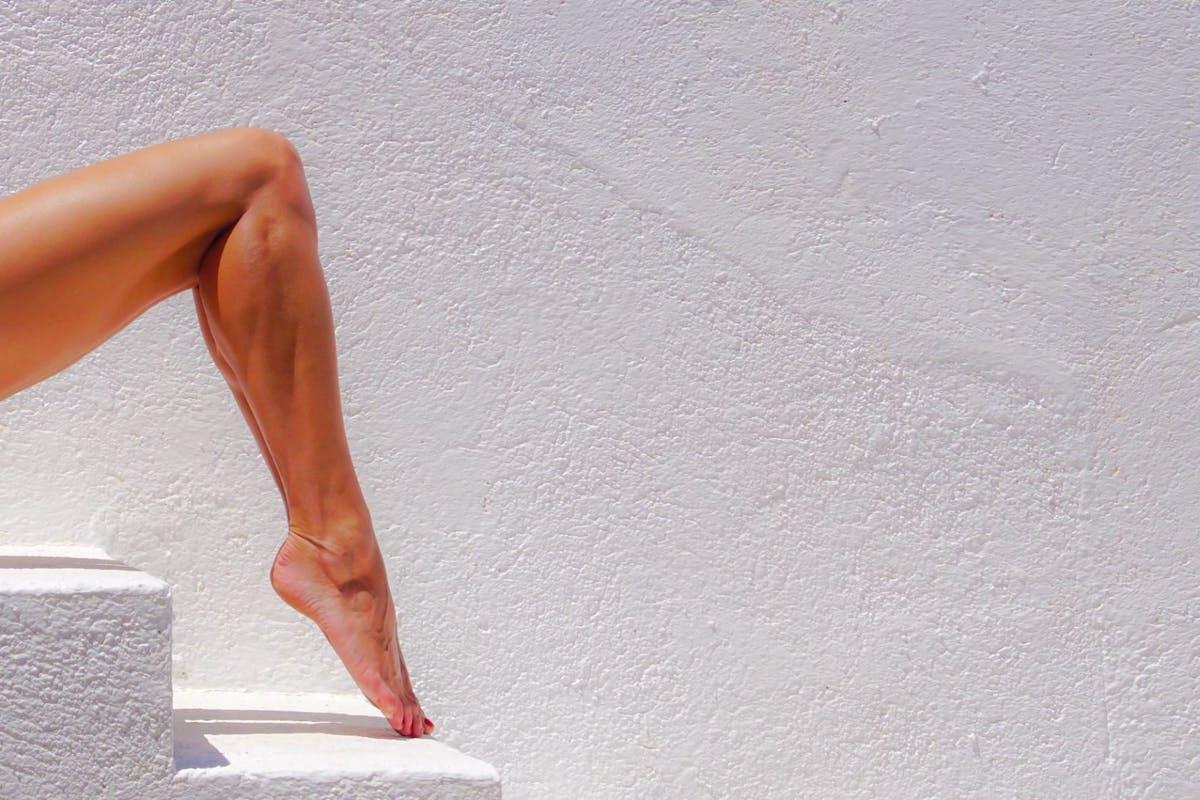 A woman extending her calves