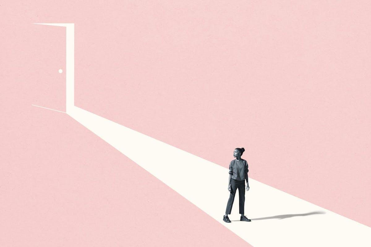 Woman in front of pink door
