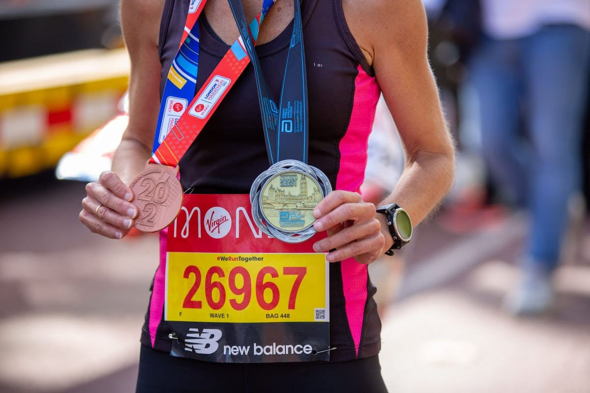 A woman with her maraton medals
