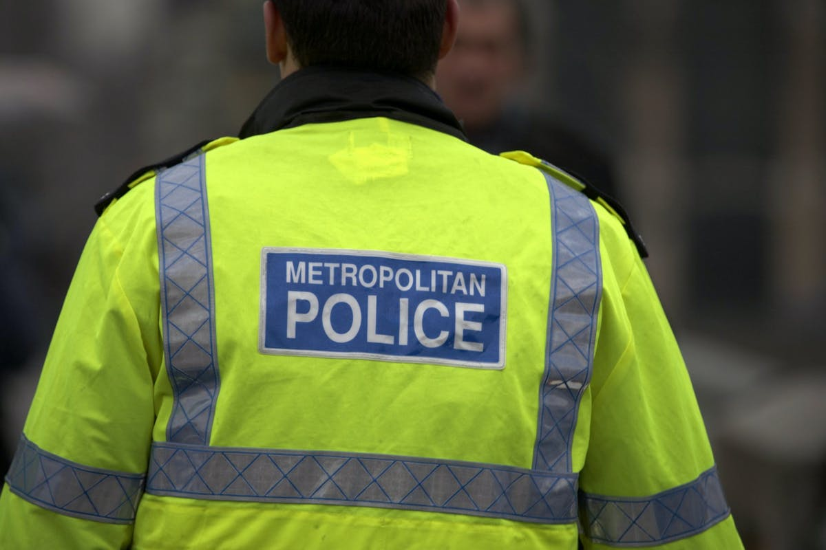 The back of a jacket which says Metropolitan Police