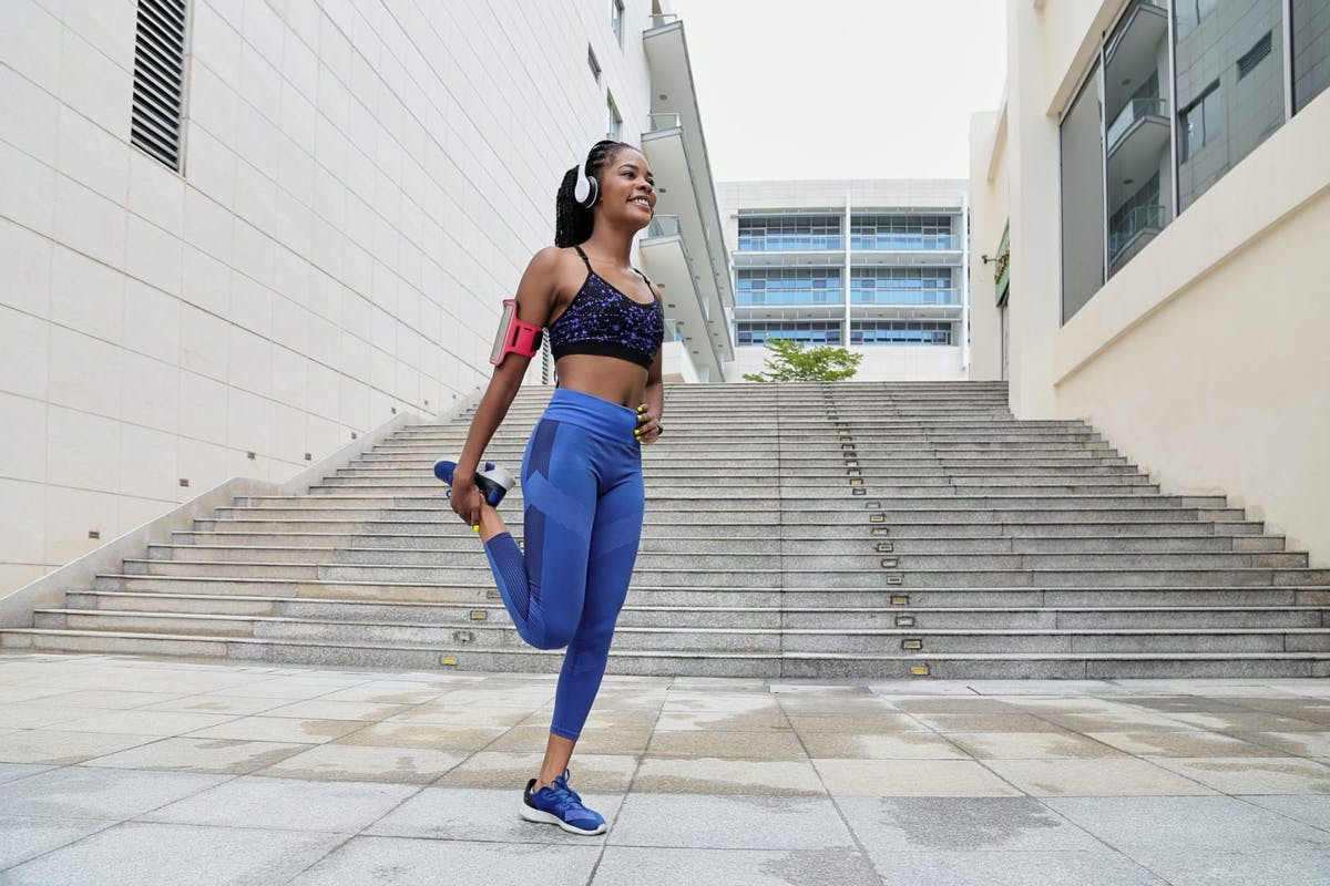 woman quad stretch running